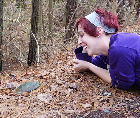 Animal Keeper Katie is delighted to see the little male slider.